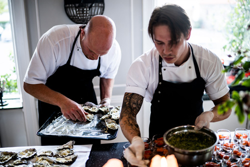 chefs with oysters