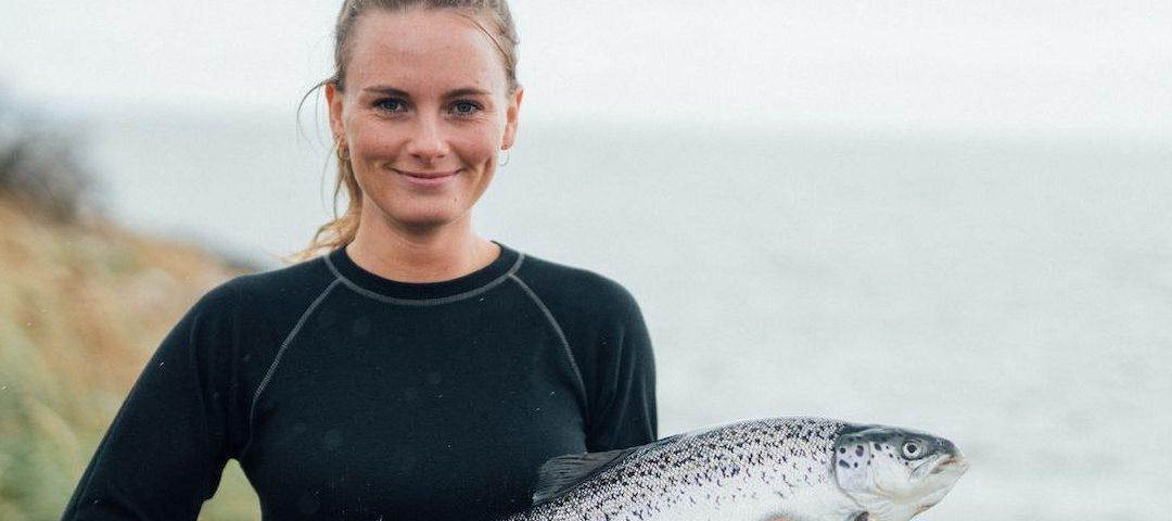 woman holding salmon